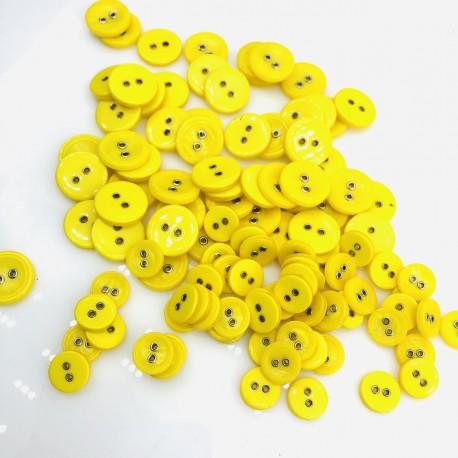 Żółte z metalowymi dziurkami